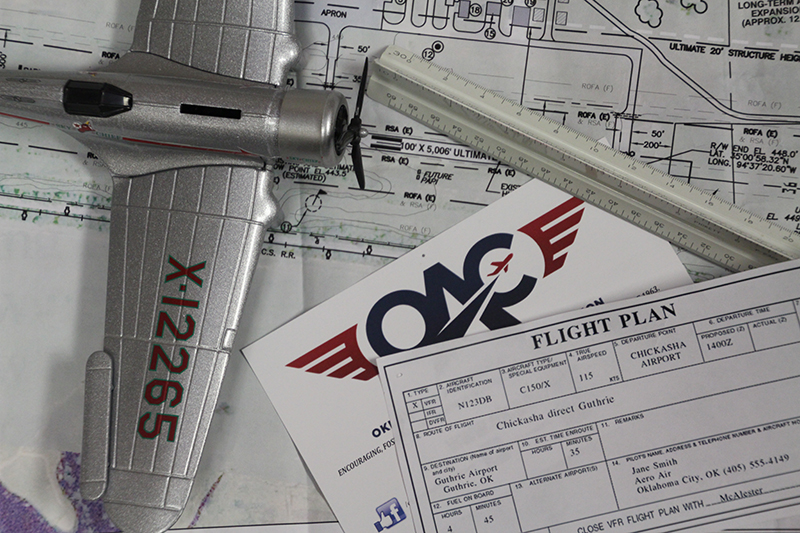 oac logo and model airplane